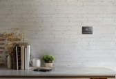 Crestron releases touch screen smart thermostat, with two-wire installation.